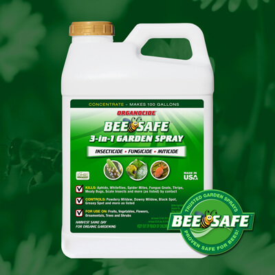 green and white 2.5 gallon container of bee safe organic pest garden spray concentrate twist on cap over green flower field