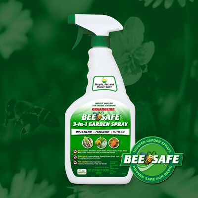 green and white 24 ounce spray nozzle bottle of bee safe organic pest garden spray over green flower field