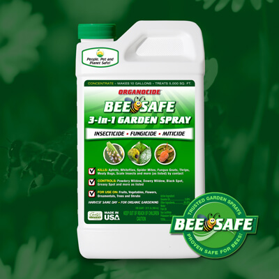 green and white quart container of bee safe organic pest garden spray concentrate twist on cap over green flower field