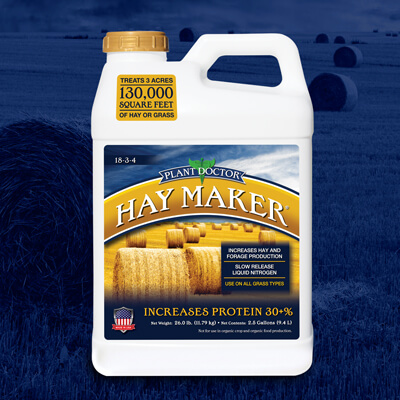 screw top 2.5 gallon container of haymaker fertilizer with blue label with hay bales over blue background of rolled bales