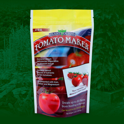 tomato maker fertilizer bag with logo and various images of tomatos atop green background of raised vegetable garden